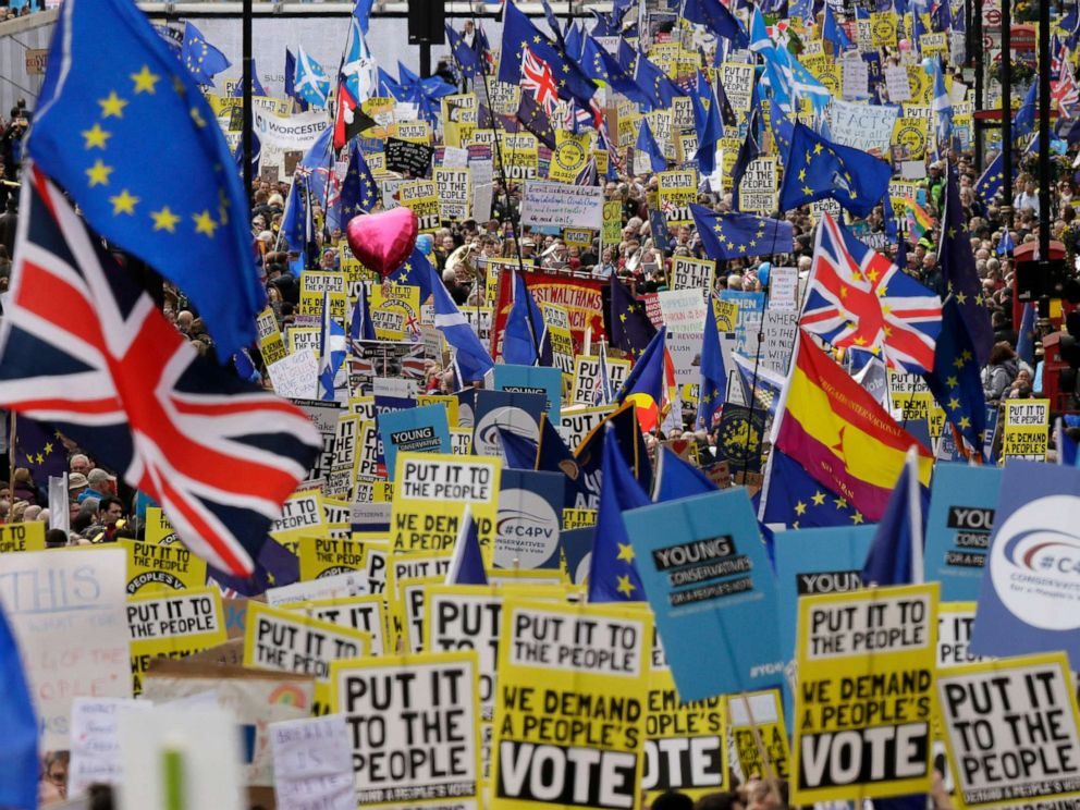 PHOTO: Demonstrators carry posters and flags during a Peoples Vote anti-Brexit march in London, March 23, 2019.