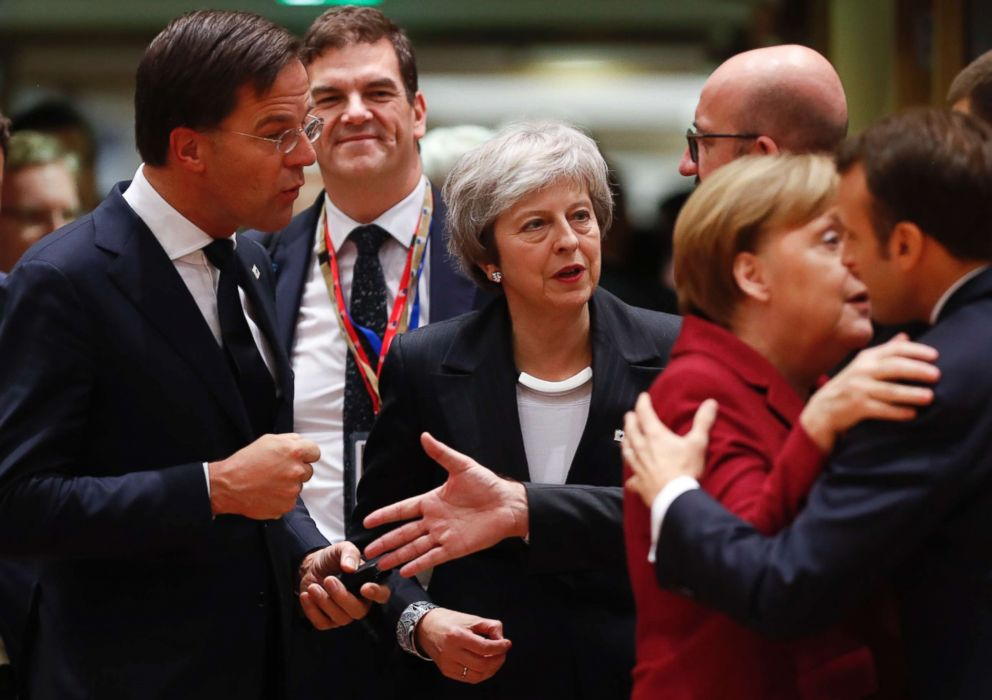 PHOTO: British Prime Minister Theresa May, center, arrives for a round table meeting at an EU summit centered on Brexit negotiations in Brussels, Dec. 13, 2018.