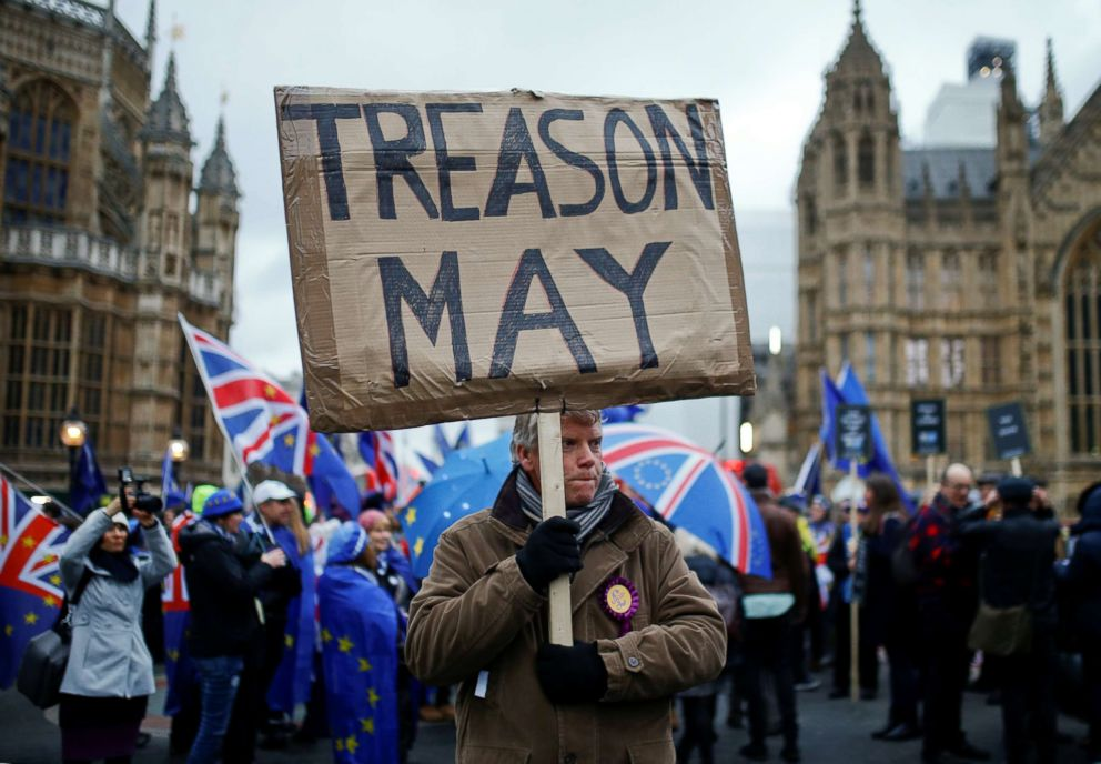 PHOTO: A pro-Brexit protester holds a banner as anti-Brexit protesters demonstrate outside the Houses of Parliament, ahead of a vote on Prime Minister Theresa Mays Brexit deal, in London, Jan. 15, 2019.
