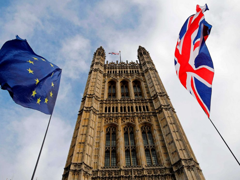 PHOTO: EU and Union flags flutter in the breeze in front of the Victoria Tower, part of the Palace of Westminster in central London, Oct. 17, 2019.