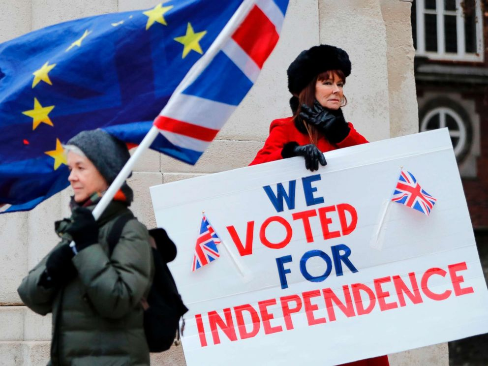 PHOTO: A pro-Brexit activist holds a placard reading We Voted For Independence as an anti-brexit campaigner waves an European Union and a Union flag outside the Houses of Parliament in London, Jan. 21, 2019.