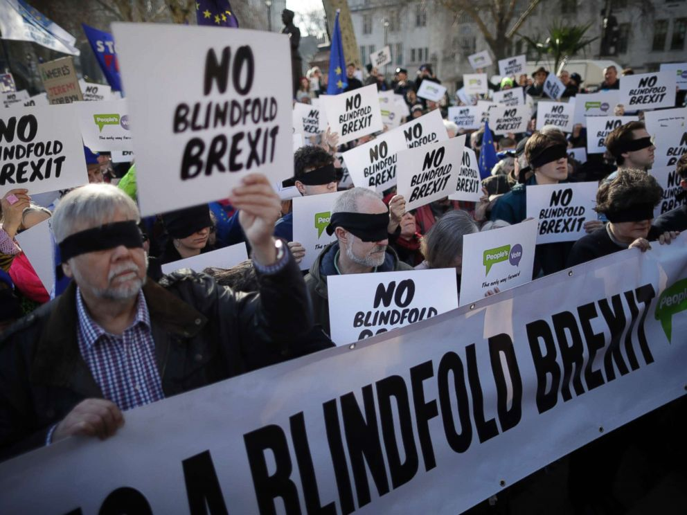 PHOTO: Anti-Brexit activists wear blindfolds as they take part in a protest event organised by the Peoples Vote Campaign, which calls for a second referendum on Britains EU membership, in Parliament Square, London, Feb. 14, 2019.