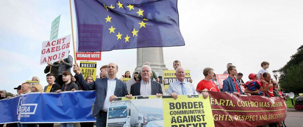 PHOTO: Anti-Brexit demonstrators protest outside Stormont house as Britains Prime Minister Boris Johnson visits Belfast on July 31, 2019.