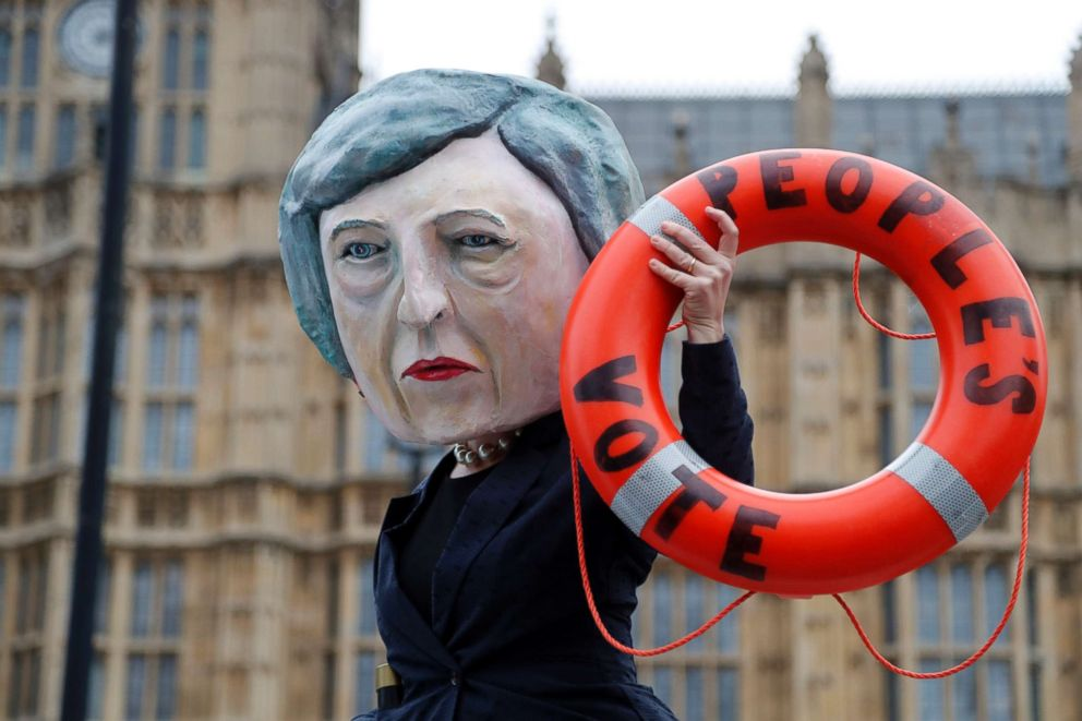 An activist from Avaaz wears a mask of Britain's Prime Minister Theresa May as Pro-European demonstrators protest opposite the Houses of Parliament in London, Jan. 15, 2019.