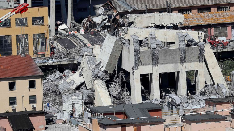 Rubble of the collapsed section of the Morandi bridge the day after the accident Genoa, Italy, Aug, 15, 2018.