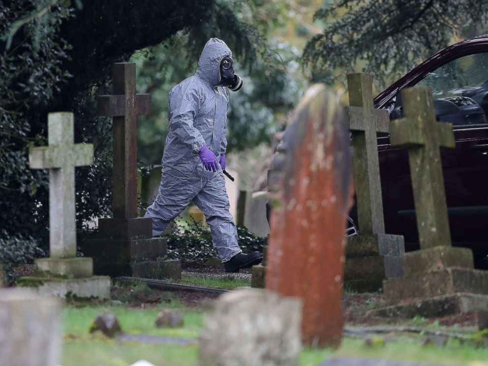 PHOTO: A member of the emergency services wearing a protective suit works at the London Road Cemetery in Salisbury, England, March 10, 2018, where the wife and son of former Russian spy Sergei Skripal are buried.