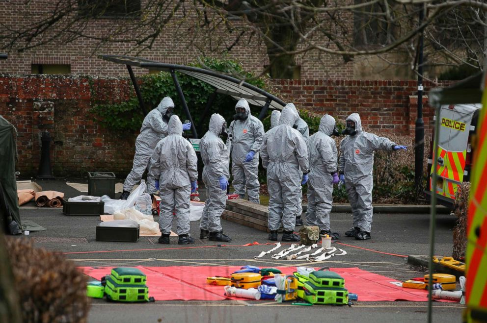 PHOTO: Military personnel wearing protective coveralls set up for an operation in a cordoned off area behind a police station in Salisbury, England, March 11, 2018.