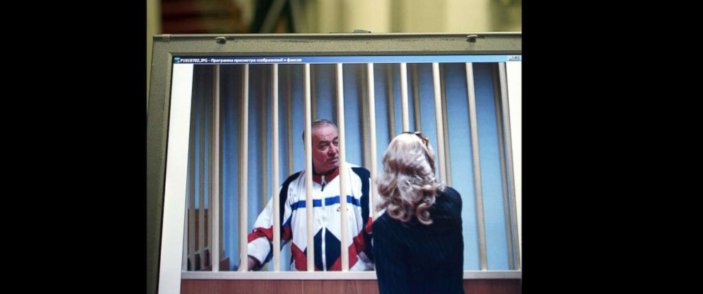 PHOTO: Sergei Skripal speaks to his lawyer from behind bars seen on a screen of a monitor outside a courtroom in Moscow in this Aug. 9, 2006 file photo.