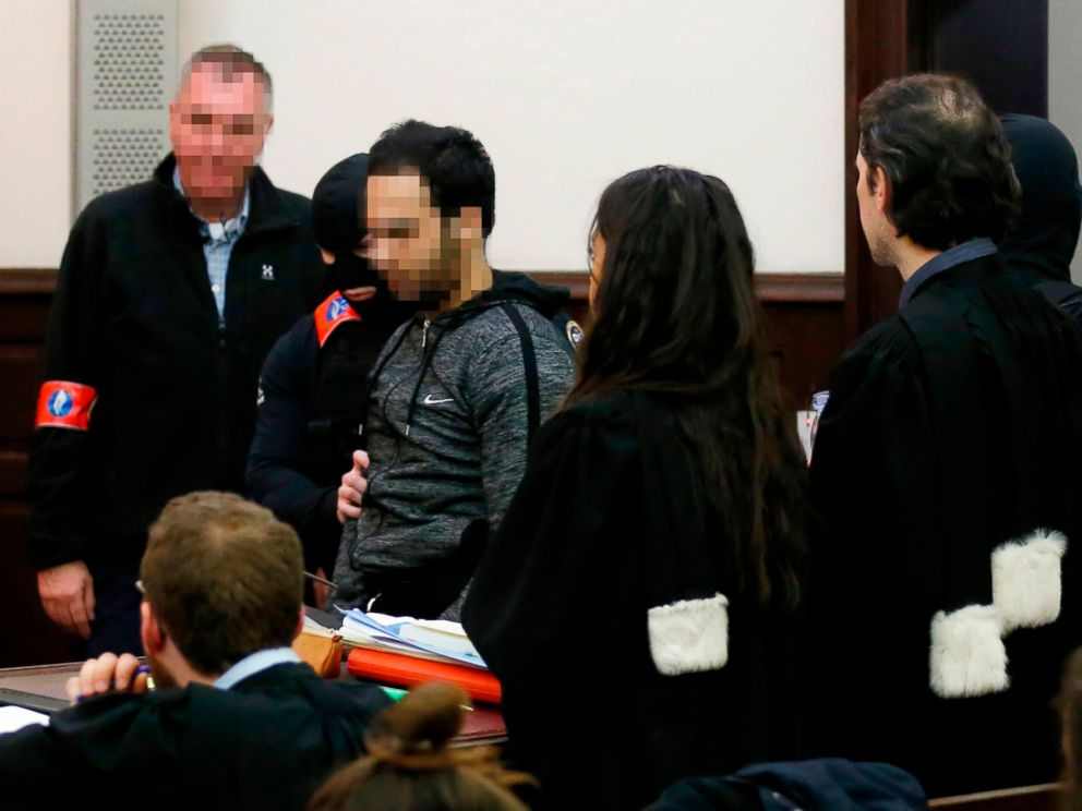 PHOTO: The alleged accomplice of the November 2015 Paris attacks suspect Salah Abdeslam, Sofiane Ayari, center, is escorted by Belgian police officers as he arrives in a courtroom in Brussels on Feb. 8, 2018.