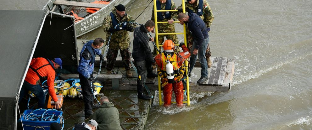 PHOTO: A diver descends a ladder to dive to the wreckage as rescuers work to prepare the recovery of the capsized boat under Margaret Bridge in Budapest, Hungary, Thursday, May 30, 2019, after a sightseeing boat collided with a large river cruise ship.