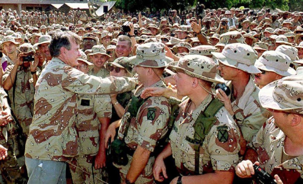 PHOTO: President George Bush reaches out to shakes hands with Marines gathered at the U.S. Embassy, Dec. 31, 1992.