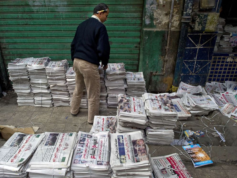 PHOTO: An Egyptian man sorts newspapers at a distribution center just off Tahrir Square in Cairo, Egypt, Dec. 2, 2011.