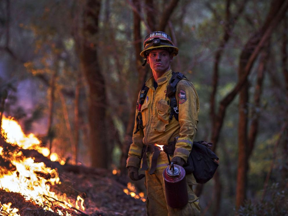 PHOTO: A firefighter uses a drip torch to set a backfire to protect houses in Adobe Canyon during the Nuns Fire on Oct. 15, 2017, near Santa Rosa, Calif.
