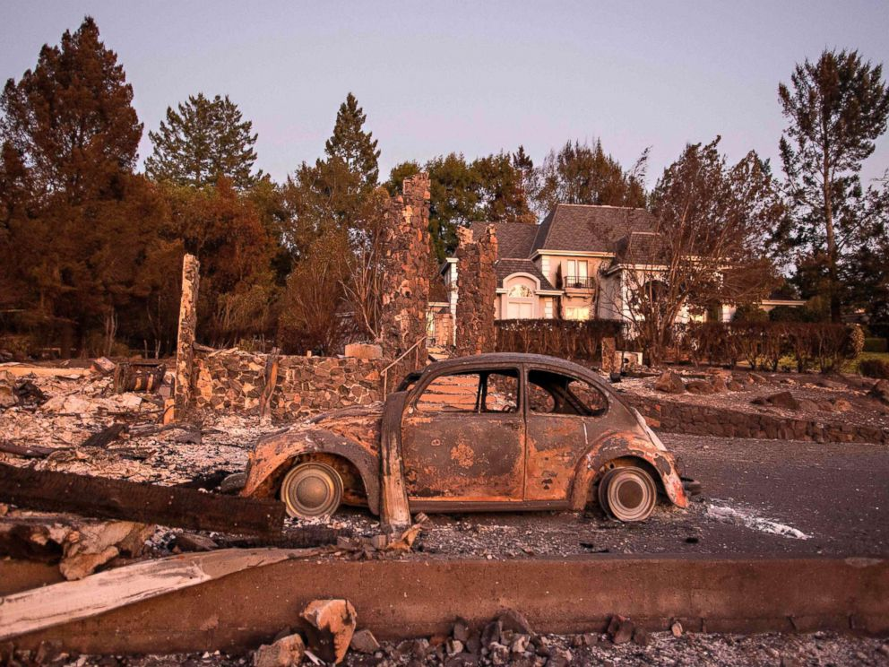 PHOTO: Charred property is seen near a home untouched by the fire in Santa Rosa, Calif. on Oct. 15, 2017.