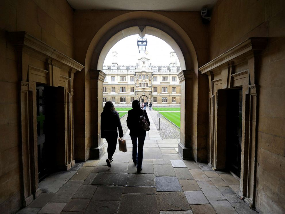 PHOTO: People walk into the quadrant of Clare College at Cambridge University in eastern England Oct. 23, 2010.