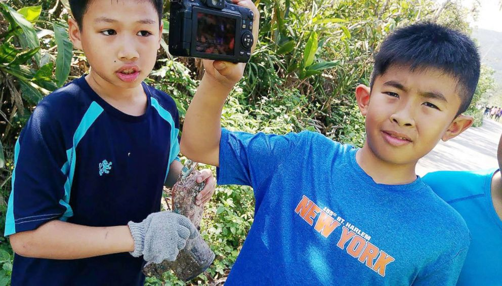 PHOTO: A school boy displays the camera which washed up on a beach in Ilan County, northeast Taiwan, March 27, 2018.