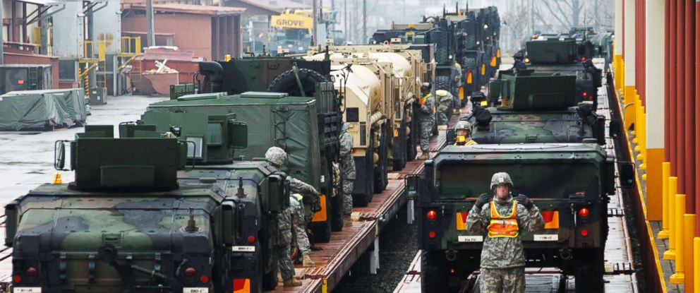PHOTO: FILE PHOTO: U.S. Army soldiers load military vehicles onto trains during a U.S. Army Preposition Stocks-4 drill at Camp Carroll in Chilgok, southeast of Seoul, March 6, 2012.