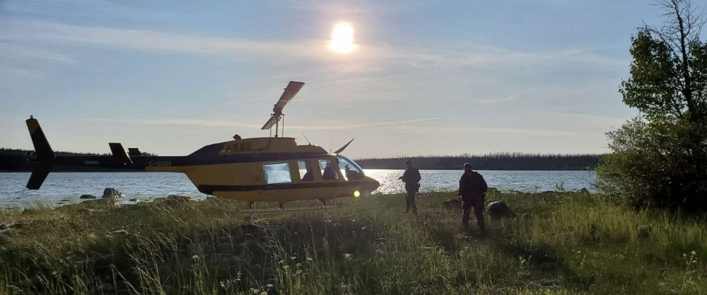 PHOTO: A handout photo made available by the Royal Canadian Mounted Police shows a RCMP officers boarding a helicopter to conduct a search in the Gilliam area of Manitoba, Canada, July 28, 2019.
