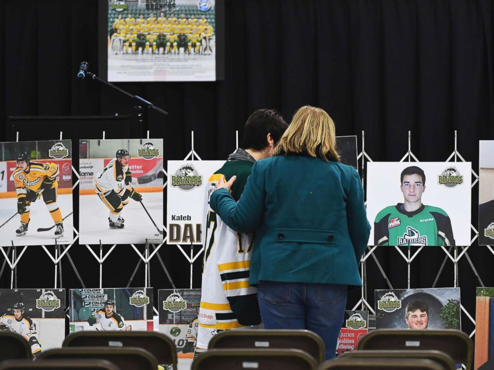 PHOTO: Mourners comfort each other as they look at photographs before a vigil at the Elgar Petersen Arena, home of the Humboldt Broncos, to honor the victims of a fatal bus accident in Humboldt, Canada, April 8, 2018.