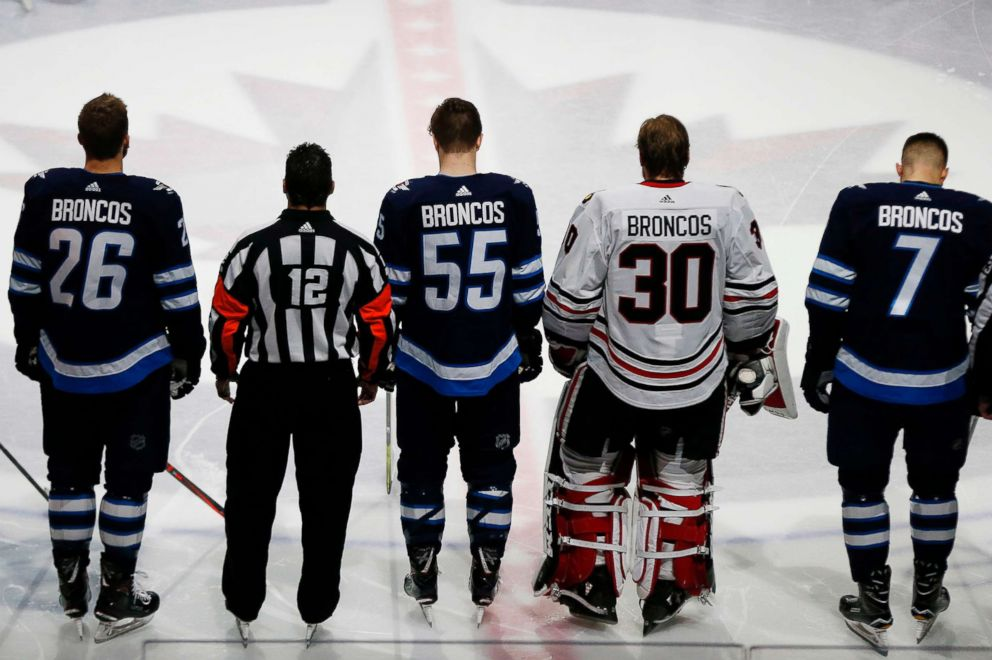 PHOTO: The Winnipeg Jets and the Chicago Blackhawks come together at center ice wearing Broncos on the back of their jerseys for a moment of silence for the Humboldt Broncos bus crash victims before NHL hockey game in Winnipeg, Manitoba, April 7, 2018.