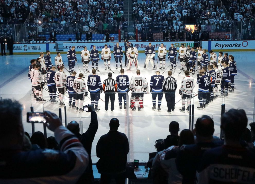 PHOTO: Winnipeg Jets and Chicago Blackhawks players honor those involved in the Humboldt Broncos bus crash tragedy before NHL action, April 7, 2018 at Bell MTS Place in Winnipeg, Manitoba.