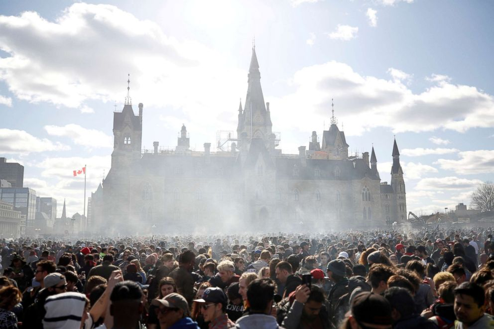 PHOTO: Smoke rises during the annual marijuana rally on Parliament Hill in Ottawa, Ontario, Canada, April 20, 2018.