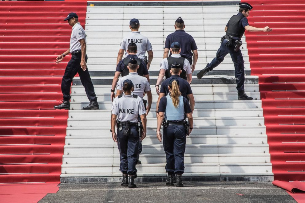 A group of police officers take part in a security exercise on the steps leading to the Palais des Festivals at the 71st international film festival, Cannes, southern France, Monday, May 7, 2018.
