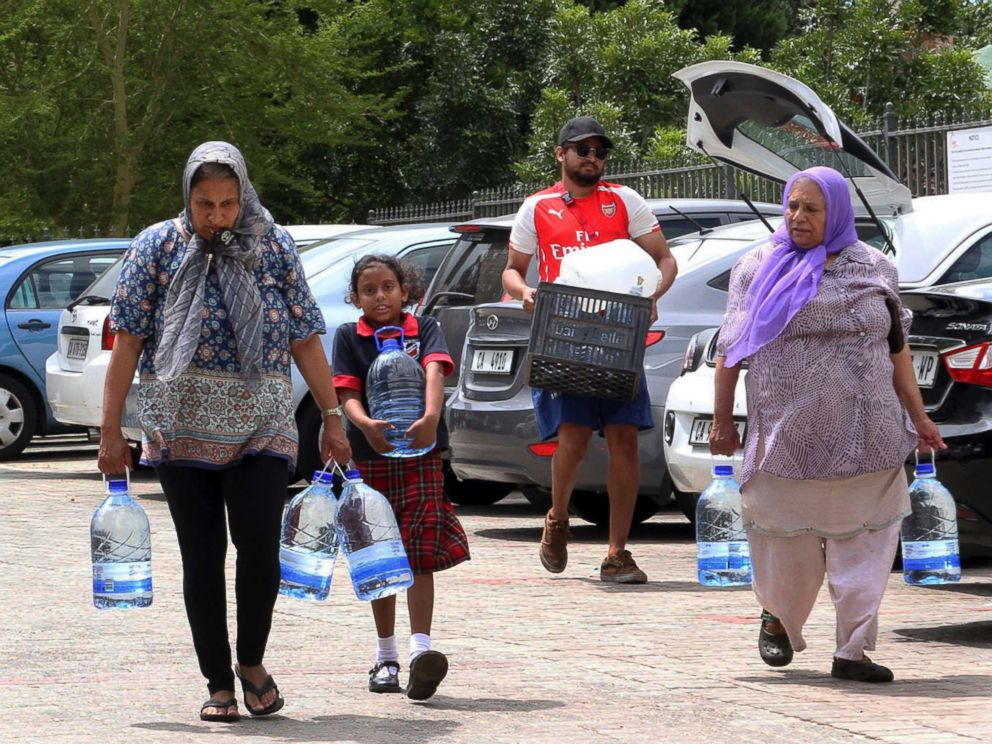PHOTO: People carry water collected from a natural spring in Cape Town, South Africa, Monday, Jan 22, 2018 as the city suffers from one of the worst droughts in recent history.