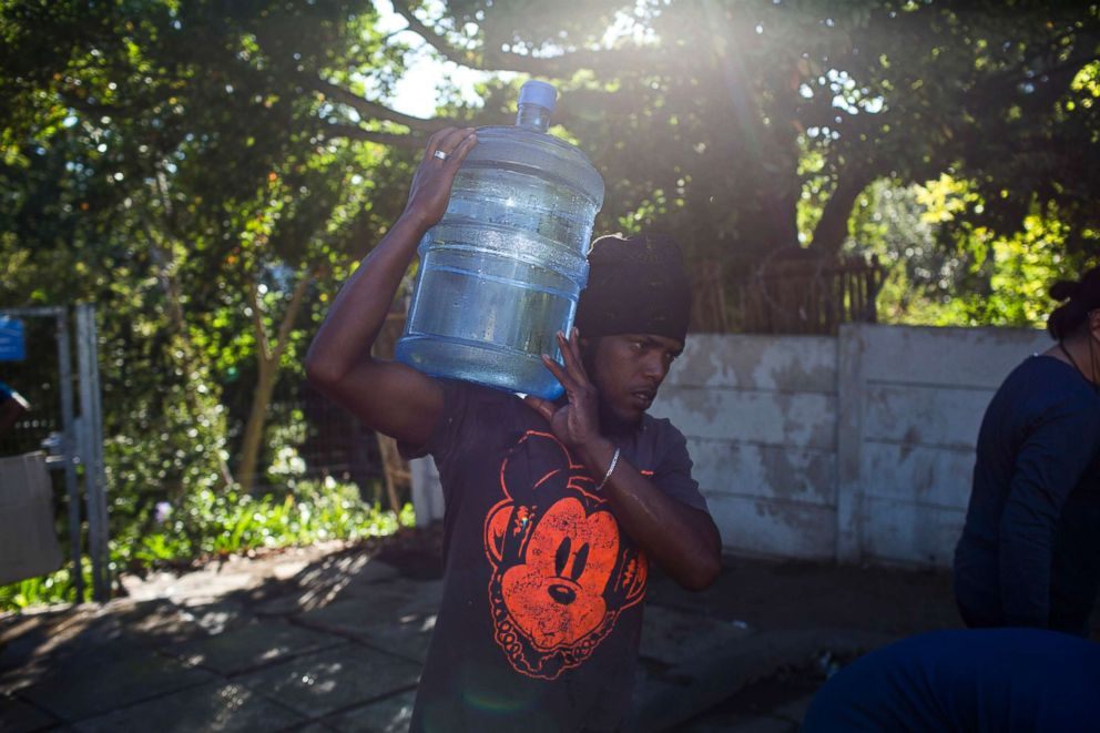 PHOTO: A man carries water from a natural spring in Cape Town, Feb. 1, 2018.