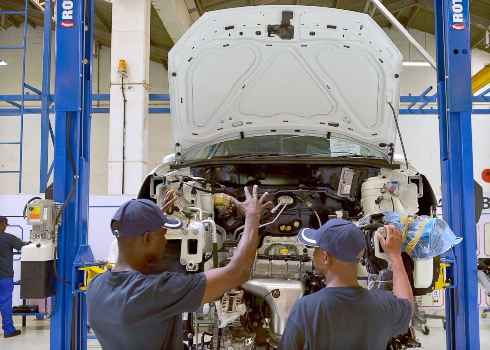 PHOTO: Technicians work on a new Polo Vivo at a newly opened assembly plant at Kenyas Thika town industrial area, Dec. 21, 2016.
