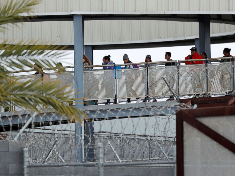 PHOTO: Caravan immigrants enter the United States border and customs facility after walking across a pedestrian bridge from Tijuana, Mexico where they are expected to apply for asylum in San Diego, California, April 29, 2018.
