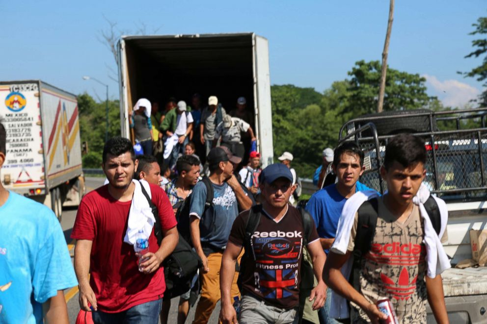 PHOTO: Dozens of migrants appear from the back of a semi truck after filling it to capacity on the way to Tapachula, Mexico.