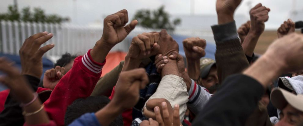 PHOTO: Migrants cheer and celebrate after hearing the news U.S. border inspectors allowed some of the Central American asylum-seekers to enter the country for processing, in Tijuana, Mexico, April 30, 2018, ending a brief impasse over lack of space.