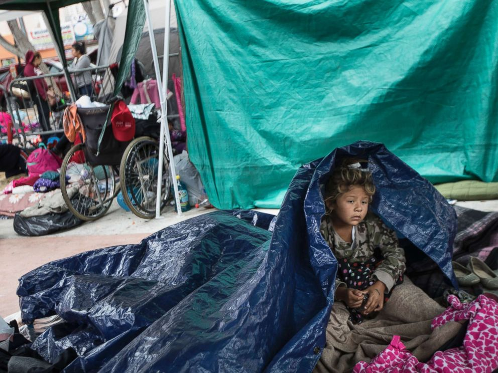 PHOTO: A girl who traveled with the annual caravan of Central American migrants waits for access to request asylum in the U.S., outside the El Chaparral port of entry building at the US-Mexico border in Tijuana, Mexico, May 1, 2018.