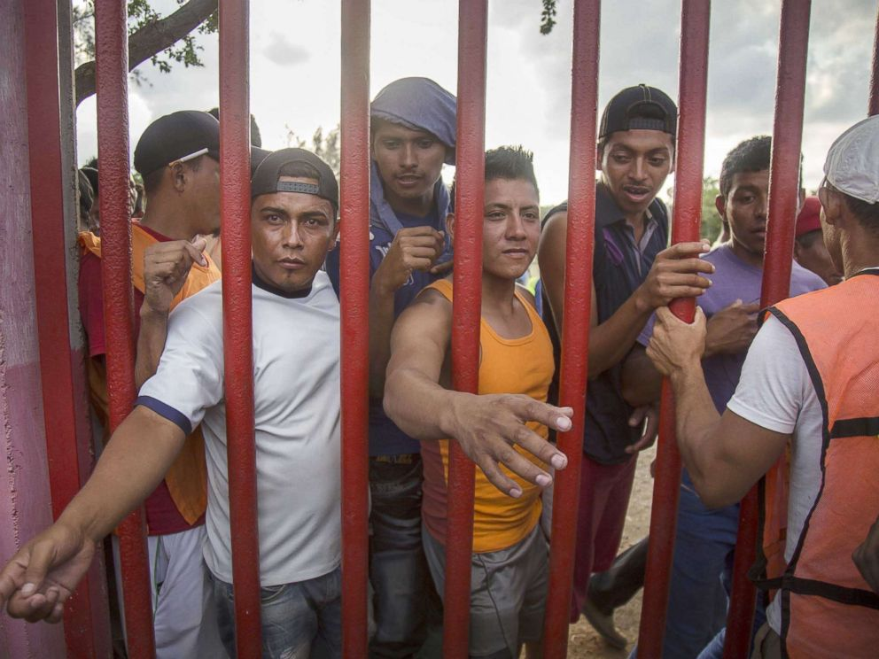 PHOTO: Central American migrants wait for food as they rest in the town of Nicolas Romero, in the state of Oaxaca, Mexico, April 3, 2018.