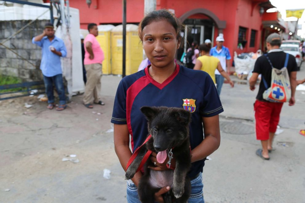 PHOTO: Kimberley Olivares, 20, said she brought her 3-month old puppy with her on the caravan from San Pedro Sula, Honduras.