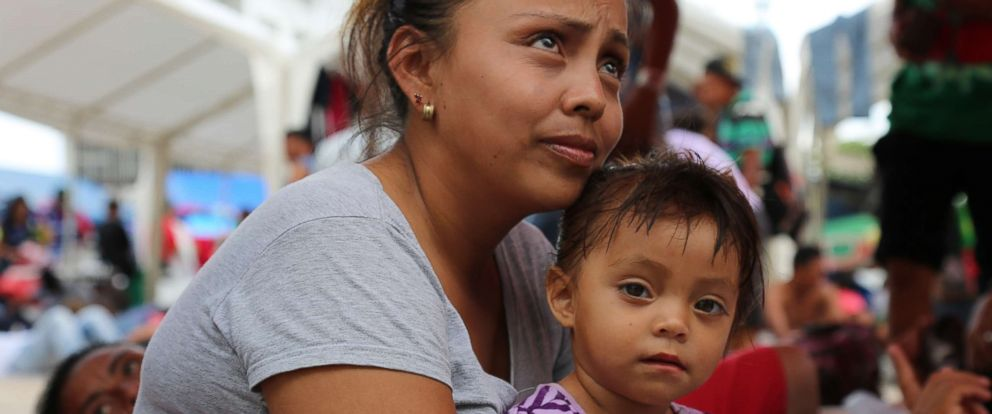 PHOTO: Maria Lucia Vigil Bardales holds her 2-year-old daughter, Meylin, but said she had to leave her 13-year-old behind.
