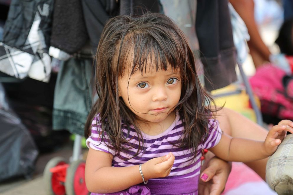 PHOTO: Meylin Bardales, 2, is traveling in the caravan with her mother. Mom made the decision to join the caravan within one day. She needs work, Meylin said.