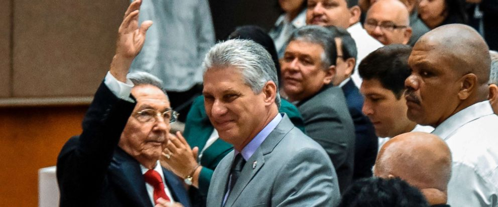 PHOTO: Cuban President Raul Castro waves next to First Vice-President Miguel Diaz-Canel, center, during a National Assembly session that will select Cubas Council of State ahead of the naming of a new president in Havana, April 18, 2018.