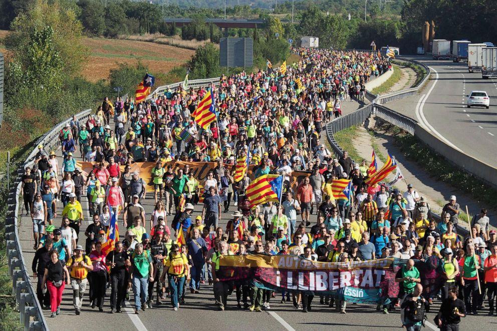 PHOTO: Demonstrators walk along a highway in Girona, Spain, Oct. 16, 2019.