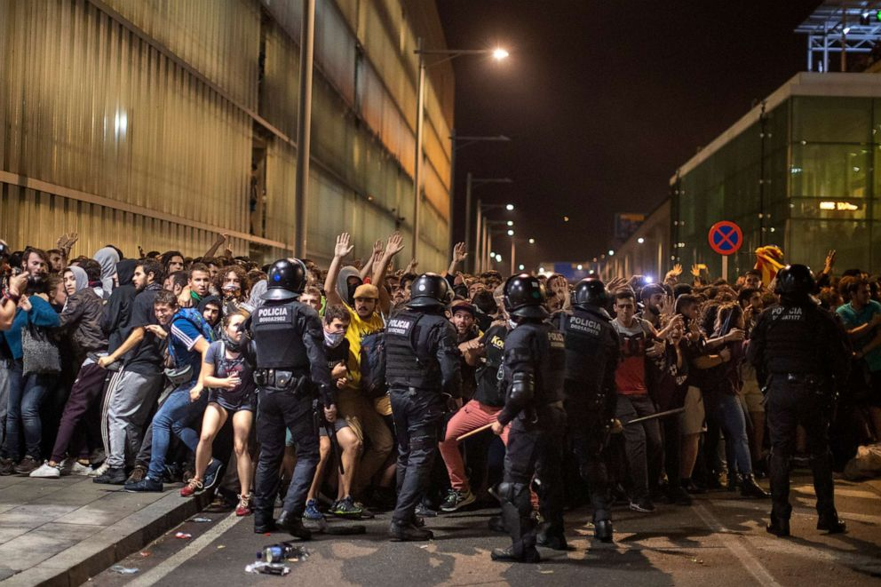 Police charge against demonstrators during clashes outside El Prat airport in Barcelona, Oct. 14, 2019.