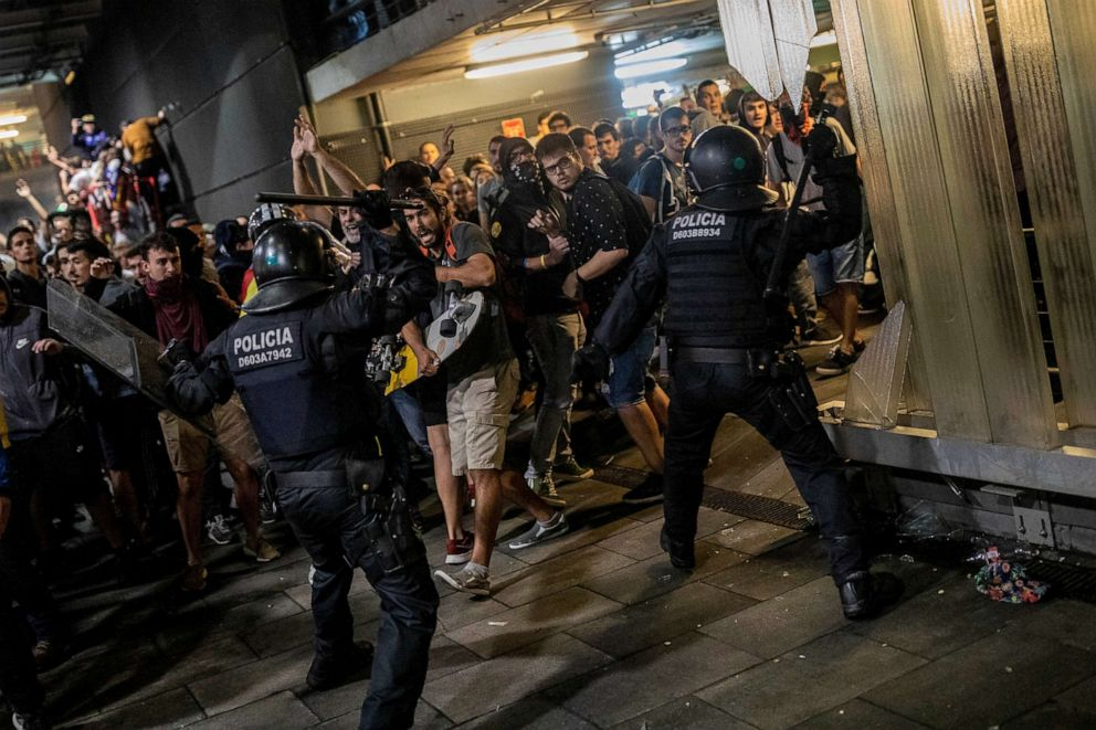 PHOTO: Police clash with demonstrators during a protest at El Prat airport, on the outskirts of Barcelona, Oct. 14, 2019.