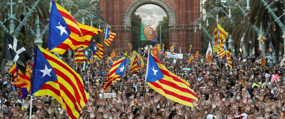 PHOTO: People attend a demonstration on the first anniversary of Catalonias banned referendum on indpendence in Barcelona, Spain, Oct. 1, 2018.