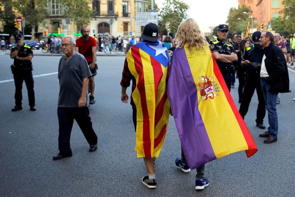 PHOTO: Protestors wear flags during a demonstration on the first anniversary of Catalonias banned referendum on indpendance in Barcelona, Spain, Oct. 1, 2018.