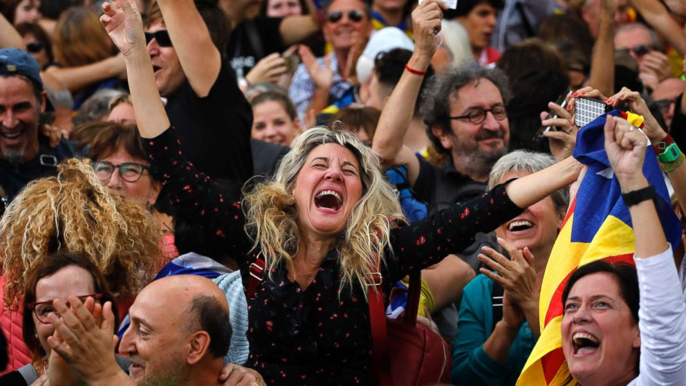 Maria Salut, center, reacts as they celebrate the unilateral declaration of independence of Catalonia outside the Catalan Parliament, in Barcelona, Spain, Oct. 27, 2017. Catalonias' regional Parliament passed a motion Friday to establish an independent Catalan Republic.