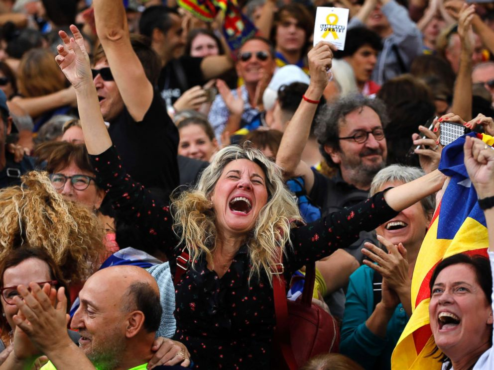 PHOTO: Maria Salut, center, reacts as they celebrate the unilateral declaration of independence of Catalonia outside the Catalan Parliament, in Barcelona, Spain, Oct. 27, 2017.