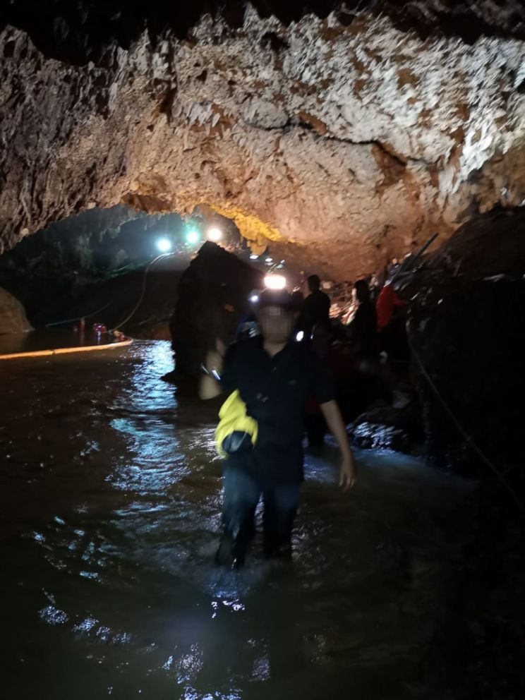 PHOTO: Rescuers work on a plan to extract 12 boys and their soccer coach trapped inside Tham Luang Nang Non cave, Chiang Rai province, Thailand.