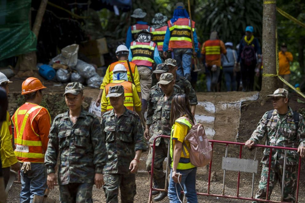 Thai soldiers and volunteers are seen at the entrance of Tham Luang cave at the Khun Nam Nang Non Forest Park in Mae Sai district of Chiang Rai province, July 5, 2018.