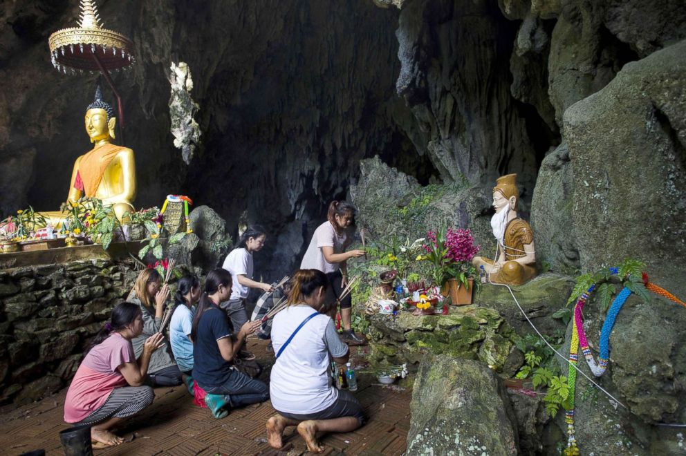 PHOTO: Family members pray before a shrine in Tham Luang cave area as operations continue for the 12 boys and their coach trapped at the cave at Khun Nam Nang Non Forest Park in the Mae Sai district of Chiang Rai province, July 5, 2018.