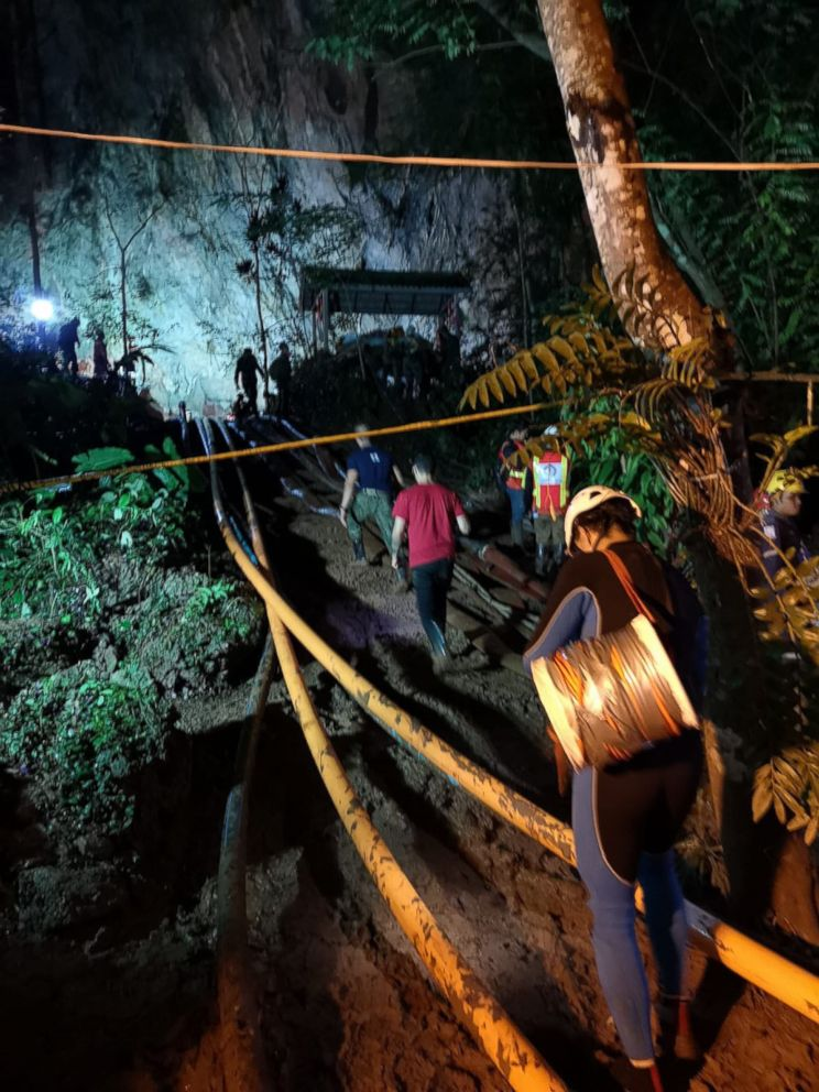 PHOTO: Rescuers work on a plan to extract 12 boys and their soccer coach trapped inside the Tham Luang Nang Non cave, Chiang Rai province, Thailand.